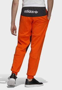 adidas Originals - ADVENTURE FIELD JOGGERS - Tracksuit bottoms - orange - 1