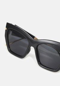 ALDO - TRELOAN - Sunglasses - black/gold-coloured/multi - 3