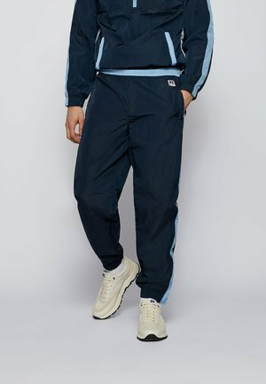 JANYL_RA - Tracksuit bottoms - dark blue