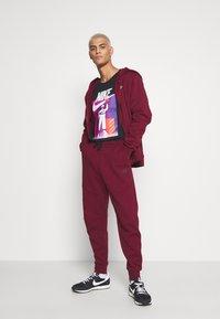Nike Sportswear - TEE AIRMAN FUTURA - Print T-shirt - black - 1