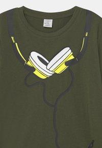 Lindex - MINI STREET PLACED PRINT - Long sleeved top - khaki green - 2
