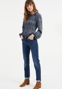 WE Fashion - MET SUPER STRETCH - Slim fit jeans - dark blue - 1