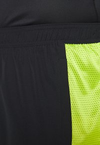 adidas Performance - OWN THE RUN - Sports shorts - black/signal green - 5