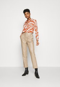 Monki - ASSA BLOUSE - Button-down blouse - orange - 1