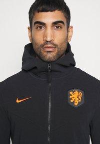 Nike Performance - NIEDERLANDE KNVB HOODIE  - Sudadera con cremallera - black/safety orange - 5