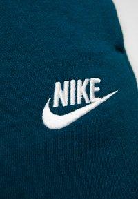 Nike Sportswear - Tracksuit bottoms - midnight turq/white - 6