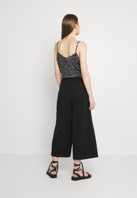 ONLY - ONLKIRAS LIFE CULOTTE PANTS - Trousers - black - 2