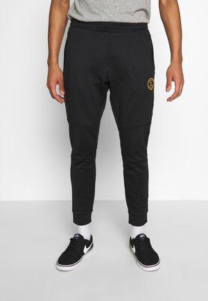 CANADA AMINO - Pantalones deportivos - black