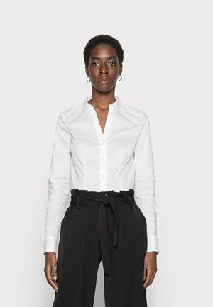 ONLAMINTA-GRACIE WIDE PAN - Trousers - black