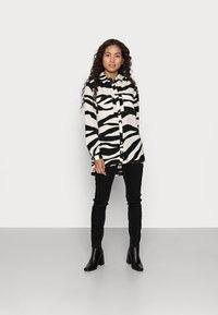 VILA PETITE - VIOMINA - Button-down blouse - black - 1