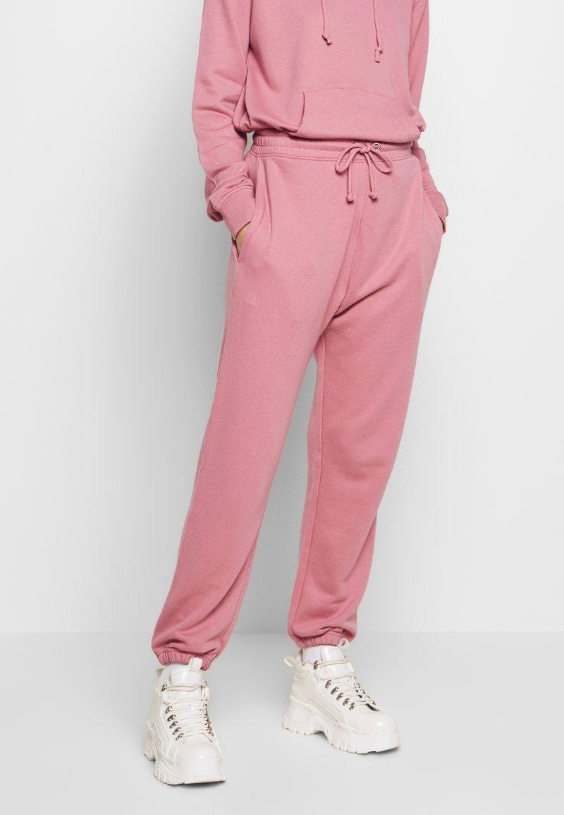 Missguided - OVERSIZED JOGGER - Pantalon de survêtement - pink