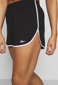 Reebok - SLIT SHORT - Pantalón corto de deporte - black - 4
