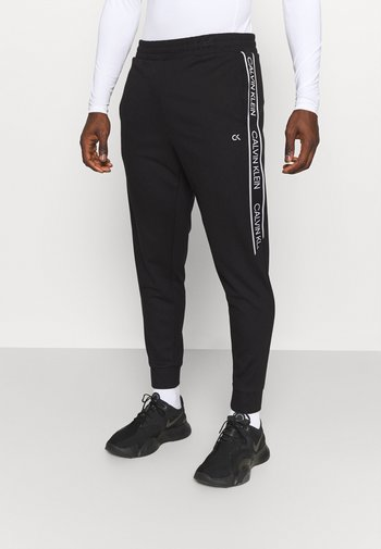 PANTS - Träningsbyxor - black