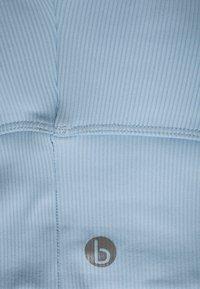 Cotton On Body - V NECK VESTLETTE - Sujetador deportivo - baby blue - 2