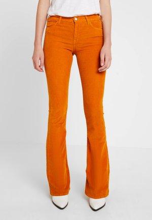 STELLA - Trousers - cognac
