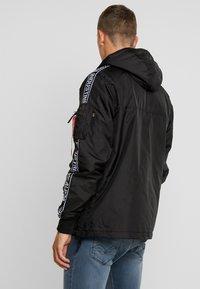 Alpha Industries - AL TAPE ANORAK - Light jacket - black - 2