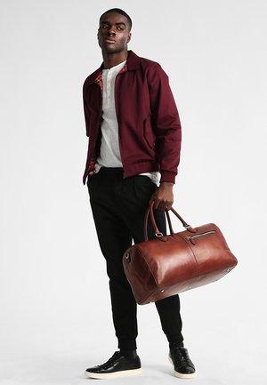 DOMUS - Weekend bag - cognac