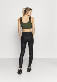 Under Armour - RUSH TONAL LEG  - Leggings - black - 2