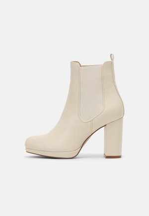 High heeled ankle boots - off-white