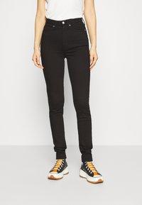 Calvin Klein Jeans - HIGH RISE  - Skinny džíny - eternal black - 0