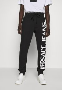 Versace Jeans Couture - BIG LOGO JOGGERS - Træningsbukser - black - 0