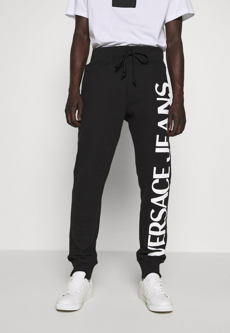 Versace Jeans Couture - BIG LOGO JOGGERS - Træningsbukser - black