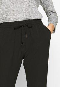 ONLY - ONLNOVA LUX PANT SOLID - Pantalones - black - 4