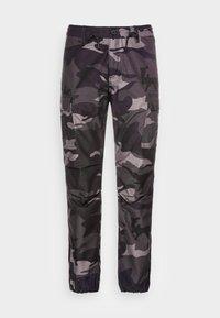 RIDGE JOGGER - Cargo trousers - dark green