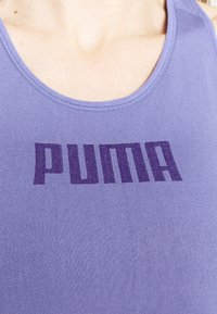 Puma - EVOSTRIPE BRA - Light support sports bra - hazy blue - 4