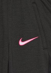 Nike Performance - DRY ACADEMY - Tracksuit bottoms - dark smoke grey/heather/hyper pink/hyper pink - 2