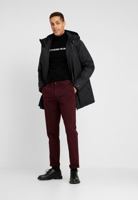Tommy Hilfiger - DENTON - Trousers - red - 1