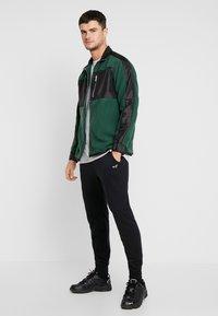 Hollister Co. - CORE  - Teplákové kalhoty - black - 1