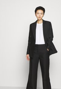 DESIGNERS REMIX - HAILEY FLARE - Trousers - black - 3