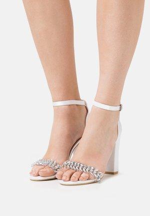ALANDRA - Sandals - ivory