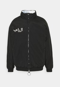 Grimey - ARCH RIVAL REVERSIBLE PUFFY JACKET UNISEX - Winter jacket - black