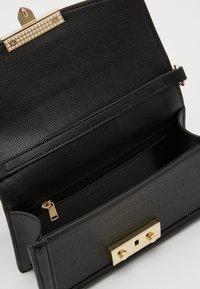 Seidenfelt - ROROS MINI - Across body bag - black - 2
