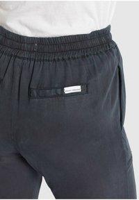 khujo - MARIZA - Tracksuit bottoms - grau gewaschen - 8