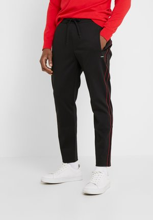 DAVEL  - Trousers - black