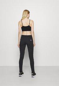 Fila - KARLA - Teplákové kalhoty - black - 2