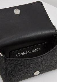 Calvin Klein - SIGNATURE FLAP XBODY - Across body bag - black - 4