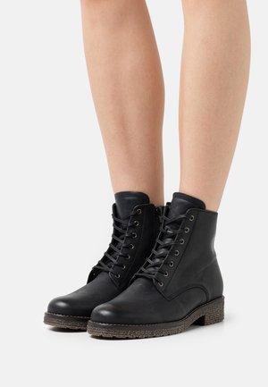 Šněrovací kotníkové boty - schwarz