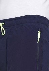 Puma - PARQUET - Pantalon de survêtement - peacoat - 5