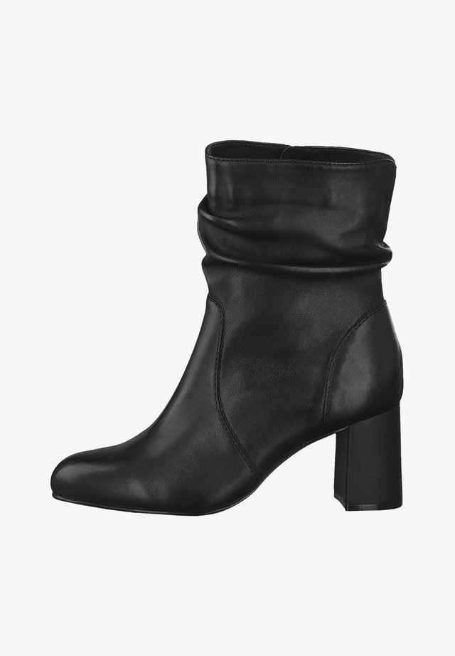 STIEFELETTE - Classic ankle boots - black