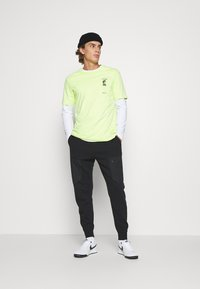 Nike Sportswear - Tracksuit bottoms - black - 1
