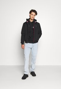 Tommy Jeans - ESSENTIAL PADDED JACKET - Light jacket - black - 1