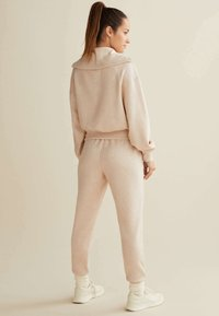 OYSHO_SPORT - Pantalon de survêtement - mottled beige - 2