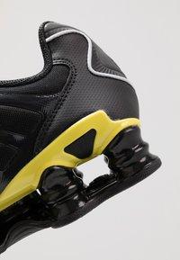 Nike Sportswear - SHOX TL - Sneakers - black/metallic silver/dynamic yellow - 8