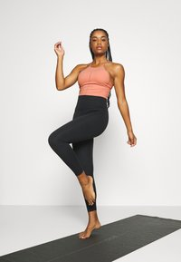 Nike Performance - YOGA CROP TANK - Sports shirt - rust pink/particle beige - 1