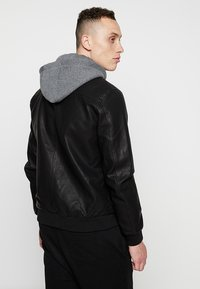YOURTURN - Faux leather jacket - black