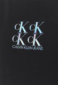 Calvin Klein Jeans - SHINE LOGO RACER BACK - Top - black - 6